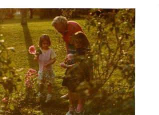 my sister and I cutting roses with Mama Ruthie (my great grandmother)